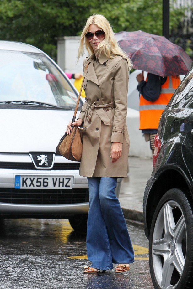 Former supermodel Claudia Schiffer looking chic in a beige trench coat after doing the school run in London